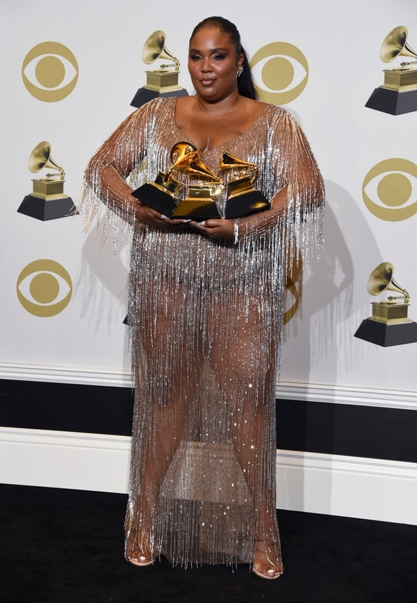 Lizzo poses in the press room with the awards for best pop solo performance for